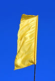 Yellow festive flag waving in the wind Royalty Free Stock Image