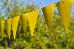 Yellow festive flags. In a garden party Stock Photo