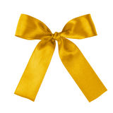 Yellow festive tied bow made from ribbon Royalty Free Stock Images