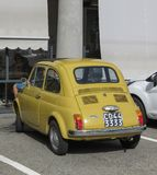 Yellow Fiat 500 car in Pont Saint Martin Royalty Free Stock Photography