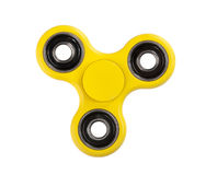 Yellow Fidget Spinner on white background stock photo