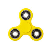 Yellow Fidget Spinner on white background stock photos