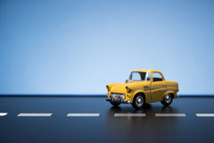 Yellow fifties toy model car. Classic fifties scale model toy car from front view royalty free stock photo