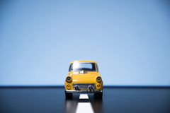 Yellow fifties toy model car. Classic fifties scale model toy car from front view stock images