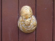 Yellow figure door knob. In Venice Royalty Free Stock Photography