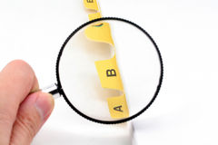 Yellow file divider and magnifier Stock Photos