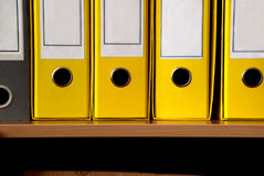 Yellow files row. Yellow files in row on shelf close up Royalty Free Stock Photos