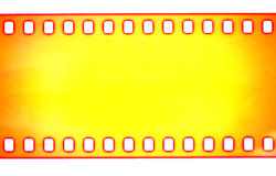 Yellow Film strip, macro shot.  Royalty Free Stock Image