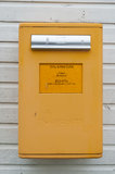 Yellow finnish letter-box Royalty Free Stock Images