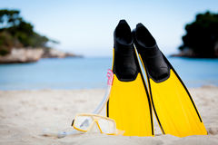 Yellow fins and snorkelling mask on beach in summer Stock Image