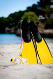 Yellow fins and snorkelling mask on beach in summer Royalty Free Stock Photos