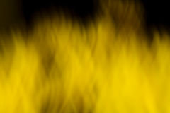 Yellow fire. Abstract image with blured yellow flames full of energy Stock Image