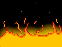 Yellow fire on a black background Stock Photos