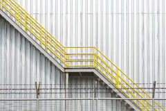 The yellow fire escape stair Royalty Free Stock Images