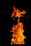 Yellow Fire flame isolated on black background Royalty Free Stock Photo