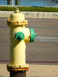 Yellow fire hydrant next Stock Photo