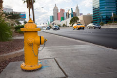 A yellow fire hydrant on road Royalty Free Stock Photography