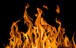 Yellow fire sparks isolated on black Royalty Free Stock Images