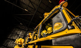 Yellow Firetruck with helmets visible Royalty Free Stock Image