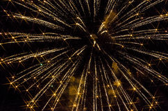 Yellow Fireworks. Shooting Yellow Fireworks with Stars Royalty Free Stock Photo