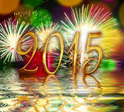 2015, yellow fireworks. And water reflections Royalty Free Stock Photography
