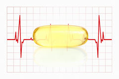 Yellow fish oil capsule and electrocardiogram Stock Images