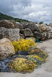 Yellow fisherman fishing nets left on the ground. Tangled yellow fisherman fishing nets left abandoned and piled up on the shore of in Zante Island, Greece royalty free stock images