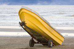 Yellow fishing boat Stock Photos