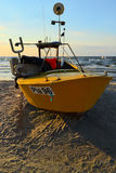 A yellow fishing boat. Royalty Free Stock Photo