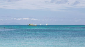 Yellow Fishing Boat and Two Sailboats Royalty Free Stock Image
