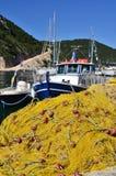 Yellow fishing net Stock Images