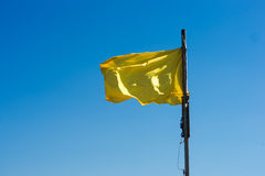 Yellow flag. As a warning on a beach Royalty Free Stock Image