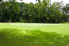 Yellow flag at the beautiful golf course Stock Photography