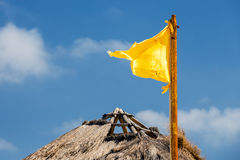 Yellow flag and blue sky Royalty Free Stock Image