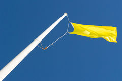 Yellow Flag and Blue Sky Stock Image