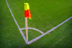 Yellow flag in corner of football playground, lazy wind blowing. Royalty Free Stock Photos