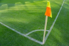 Yellow flag in corner of football playground, lazy wind blowing. Stock Image