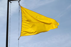 Yellow flag - Dangerous swimming Stock Images