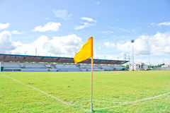Yellow flag at field Stock Photo