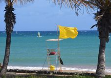 Yellow Flag Flying at Las Cucharas Beach Costa Teguise. Lanzarote Royalty Free Stock Image