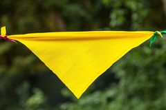 Yellow flag from a garland in the park.  royalty free stock photography