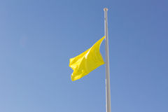 Yellow Flag at Half Mast Stock Image