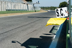 Yellow flag on motor sport track. Yellow flag and safety car banner on motor sport track during race stock images