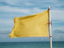 Yellow flag on the sea Stock Photography