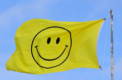 Yellow flag with smiley face Stock Image