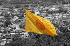 Yellow flag is a symbol of Buddhism in Thailand. Stock Image