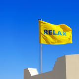 Yellow flag with a word Relax Stock Photo