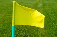 Yellow flags on the green grass of a football playing field. Royalty Free Stock Photo