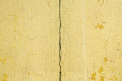 Yellow flaky paint on a wooden background Royalty Free Stock Photography