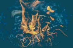Yellow Flame on Clear Water Stock Photography
